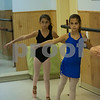 JIM VAIKNORAS/Staff photo Regan Mahoney, 9, and Katie Caraco, 9, practice tondos in Kristina Simopoulos at LaPierre Dance School.