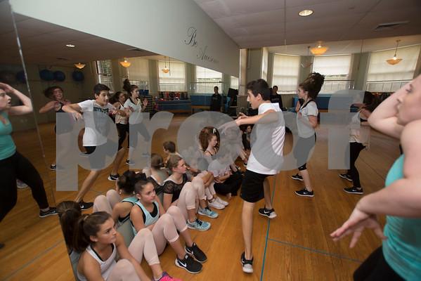 JIM VAIKNORAS/Staff photo Sebastian Amico, center, with the Competitive Dance Team at Lapierre Dance Studio.