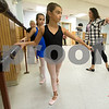 JIM VAIKNORAS/Staff photo Regan Mahoney, 9, in black, and Katie Caraco, 9, practice tondos in Kristina Simopoulos at LaPierre Dance School.