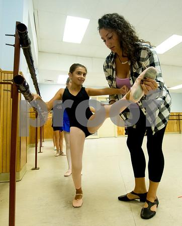 JIM VAIKNORAS/Staff photo Teacher Kristina Simopoulos works wit Reagan Mahoney, 9, during  ballet class at LaPierre Dance Sudio in Reading.