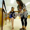 JIM VAIKNORAS/Staff photo Teacher Kristina Simopoulos works wit Reagan Mahoney, 9, during  ballet class at LaPierre Dance Sudio in Reading.