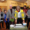 CARL RUSSO/Staff photo. READING MAG. Natural Food Exchange in Reading had their reopening celebration on April 1st. Valerie Mata, owner  of Natural Food Exchange cuts the cake.  4/1/2015.