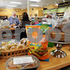 CARL RUSSO/Staff photo. READING MAG. Natural Food Exchange in Reading had their reopening celebration on April 1st. Hal Vincent helps a customer. 4/1/2015.