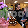 CARL RUSSO/Staff photo. READING MAG. Nautral Food Exchange in Reading had their reopening celebration on April 1st. Sara Burd watches her daughter, Aurora, 19 months, enjoys a gluten free cupcake. 4/1/2015.