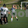 RYAN HUTTON/ Staff photo<br /> North Reading's Michelle Maidment  runs toward goalie Julia Perrone in celebration after their teammates at the other end of the field scored another goal against Pentucket during the September 14 game at the Amesbury Sports Park.