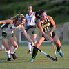 RYAN HUTTON/ Staff photo<br /> North Reading's Olivia Esposito keeps the ball away from Pentucket's Maria DeSisto during the September 14 game at the Amesbury Sports Park.