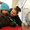 Vivian MacLauchlan, right, and her daughter Julianne, 5, look at Chumley the Gerbil, the unofficial mascot of the Reading Public Library. DAVID LE/Staff Photo 1/28/14