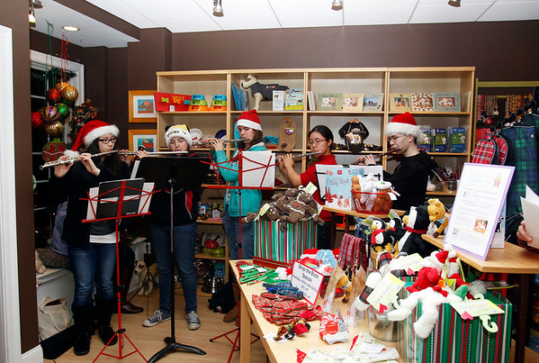 MARY SCHWALM/Staff photo  Members of the Reading Wood ensemble perform in Everything But the Dog during Shop the Block in Reading.
