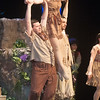 JIM VAIKNORAS/Staff photo Tiger Lily , played by Izzy Rosatone dances with the Lost Boys  in the North Reading High Production of Peter Pan.