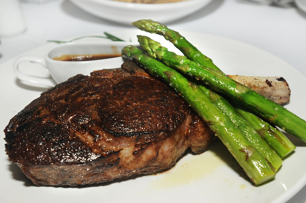 CARL RUSSO/Staff photo. READINGS MAG: Teresa's Prime Restaurant and Function Facility in North Reading. A Cowboy Rib Eye Bone-In with jumbo asparagus. 3/27/2015.