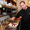 CARL RUSSO/Staff photo. READINGS MAG: Nicholas A. Yebba Jr., Executive Chef/Vice President of Operations of Teresa's Prime Restaurant and Function Facility in North Reading. He is preparing an appetizer called Bacon 13, Teresa's famous triple cut bacon, Maker's, mark bourbon glaze, marasca cherries. 3/27/2015.