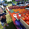 CARL RUSSO Staff photo. READINGS MAGAZINE:  The Farmers Market at Ipswich River Park in North Reading is every Wednesday from 4 pm to 7 pm. It started in June and will end on Sept. 28th. Lydon Leenders, 2 of North Reading looks at the variety of tomatoes from Arrowhead Farm of Newburyport.  6/22/2016
