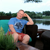MARY SCHWALM/Staff photo Scott Bechaz sits on the patio overlooking Martin Pond in his North Reading home. 6/25/14