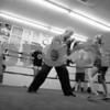 PAUL BILODEAU/Staff photo. Jim McNally spars with Antonia Zagami, 9, as , from left, Zach Taylor, Tia Martignetti, Nick Kullman look on at Jim McNally's Boxing in North Reading on Main Street.