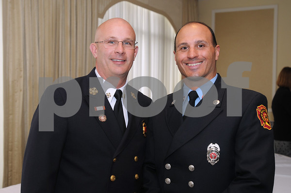 CARL RUSSO/Staff photo. READINGS MAGAZINE: Reading and North Reading's Chamber of Commerce award ceremony held at Teresa's Prime Restaurant in North Reading. North Reading Firefighter of The Year, Vincent Zarella, right and North Reading Fire Chief, William Warnock. 4/29/2015