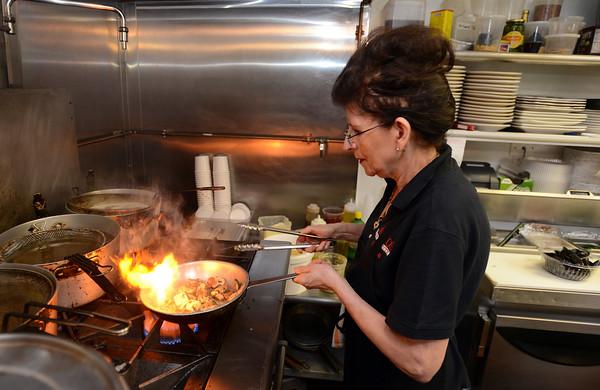 "RYAN HUTTON/ Staff photo<br /> Alfina ""Freeda"" Guevara cooks up some mushrooms on the stove at Mario's Ristorante in North Reading."