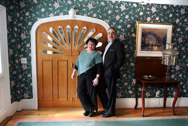 """Readings Magazine<br />  Rick Nazzaro and Bobbi Botticelli opened Colonial Manor Reality in Reading in 1989. """"The fanning on the door makes it the most prominent example of a Federalist front,"""" Botticelli said. """"It's on the national register of historic places.""""<br /> <br /> <br /> Photo by Amy Sweeney<br /> 25th anniversary of Colonial Manor Reality in Reading."""