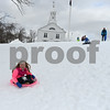 RYAN HUTTON/ Staff photo<br /> Katelyn Murphy, 7, sails down the hill at the North Reading Town Common as her brother Patrick, 9, and mother Jennifer watch from the top of the hill.