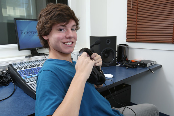 KEN YUSZKUS/Staff photo.   Pingree senior student Benjamin Esakof in the school's new sound studio.  9/23/14