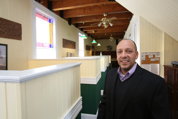 KEN YUSZKUS/Staff photo.   Jim D'Amico is the owner of The Century 21 business located in the Reading train depot at 32 Lincoln St. in Reading.    01/06/15