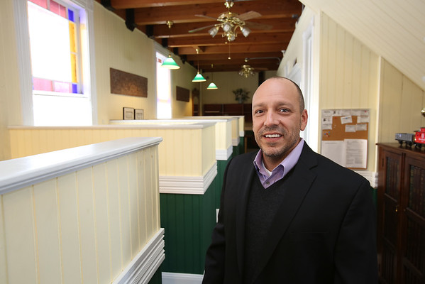 Jim D'Amico is the owner of The Century 21 business located in the Reading train depot at 32 Lincoln St. in Reading.  <br /> Photo by Ken Yuszkus<br />  01/06/15