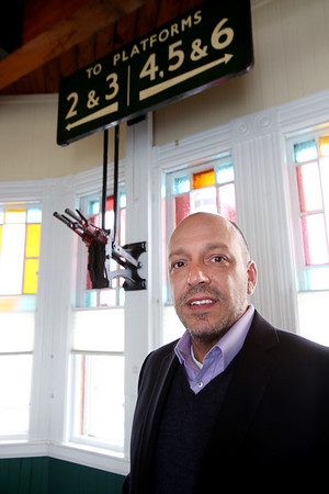 KEN YUSZKUS/Staff photo.   Jim D'Amico is the owner of The Century 21 business located in the Reading train depot . An original manual switch lever and stained glass windows are part of the decor at The Century 21 business located in the Reading train depot  at 32 Lincoln St. in Reading.    01/06/15