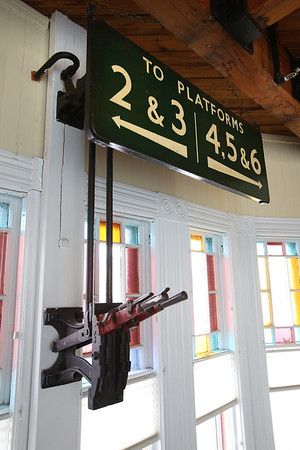 An original manual switch lever and stained glass windows at The Century 21 business located in the Reading train depot  at 32 Lincoln St. in Reading.    KEN YUSZKUS/Staff photo. <br /> 01/06/15