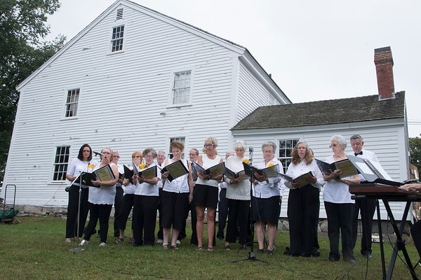 JIM VAIKNORAS/Staff photo The North Reading Senior Echos perform at the North Reading Historical and Antiquarian Society Apple Festival at the Putnam House.
