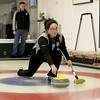 MARY SCHWALM/Staff photo Davyion Welper releases the stone during a curling match at the Nashua Country Club. 3/29/15