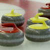 MARY SCHWALM/Staff photo Curled stones await their scoring fate in the house during a curling match at the Nashua Country Club. 3/29/15