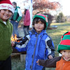 Photo/Reba Saldanha The Ruling brothers (from left) Desmond, 6, Gabriel 4, and Micah, 2, play near the fire while waiting for Santa's arrival during the Windham annual tree lighting Saturday Dec 5, 2015.