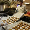 Photo/Reba Saldanha VP of Retail Sale Marc Dipersio helps bake cookies for the town's holiday celebration at AJ Letizio Sales & Marketing's Enterprise Center in Windham, NH Saturday Dec 5, 2015.