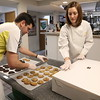 Photo/Reba Saldanha Nick Letizio and wife Pauline box fresh baked cookies for the town's holiday celebration at AJ Letizio Sales & Marketing's Enterprise Center in Windham, NH Saturday Dec 5, 2015.