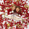 KEN YUSZKUS/Staff photo.   Twins Lilyanna, left, and Mariela Laspina, 5, of Windham are surrounded with Christmas ornaments.  10/23/15.