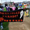 TIM JEAN/Staff photo  <br /> Children parade around the baseball field in costumes during Windham Harvest Fest at Griffin Park. 10/17/15