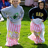 TIM JEAN/Staff photo  <br /> Katie Durkin, 10, and her brother Robert, 7, of Windham race against each other in the sack races during Windham Harvest Fest at Griffin Park. 10/17/15