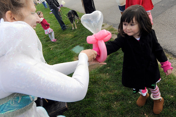 TIM JEAN/Staff photo  <br /> Tara Farrell, 4, receives a balloon bracelet from Performing Artist Linda Peck during Windham Harvest Fest at Griffin Park. 10/17/15