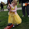 TIM JEAN/Staff photo  <br /> Abigail Slowick, 5, swings a hammer down to win a prize during Windham Harvest Fest at Griffin Park. 10/17/15