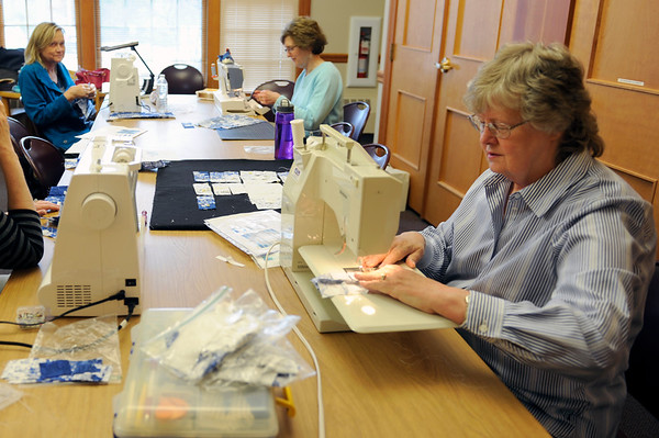 TIM JEAN/Staff photo<br />  Joyce Potter, right, and Joni Dunbar, back left, and Patricia Barstow all members of the Nesmith Quilters, work on sections of a quilt the group is making at the Nesmith Library.        4/1/16