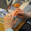 TIM JEAN/Staff photo<br /> Patricia Barstow of Windham, works on section of a quilt the group is making at the Nesmith Library.        4/1/16