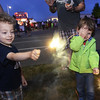 CARL RUSSO/Staff photo. Windham's 4th. of July fireworks celebration was held Thursday night. Lee Johnson, left and his best friend, Logan Michaud, both 3 have some fun with sparklers before the fireworks. 6/30/2016.