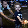 CARL RUSSO/Staff photo. Windham's 4th. of July fireworks celebration was held Thursday night. Lee Johnson, 3 plays with his sparkler with the help of a family member before the fireworks. 6/30/2016.