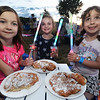 CARL RUSSO/Staff photo. Windham's 4th. of July fireworks celebration was held Thursday night. From left, Skyar Greenwood, 7 Summer Tower, 7 and Charlotte Feke, 5 enjoy their fried dough before the fireworks. 6/30/2016.