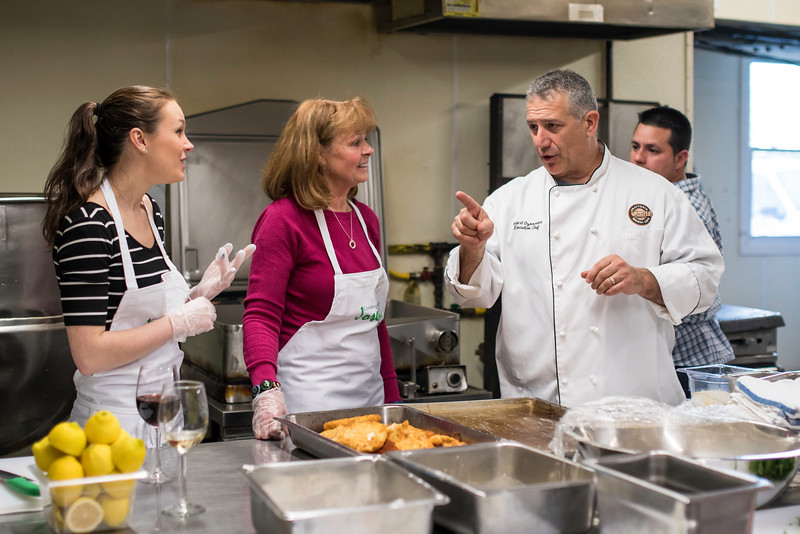 Joseph's Trattoria Chef Robert Ozoonian gives some pointers to Kate Desmond from Tewksbury and Dawn Desmond from Atkinson during the May class.<br /> Photo by Don Toothaker<br /> May 22, 2016