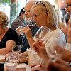 RYAN HUTTON/ Staff photo<br /> Maryann Legare sniffs a glass of red during a mystery double wine tasting at Lucia's Bodega in Windham.