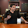 PAUL BILODEAU/Staff photo. Chuck Palazzola of Lucia's Bodega wine shop in Windham.