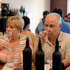 RYAN HUTTON/ Staff photo<br /> Ken and Debbie Bush, of Windham, consider the latest pour during a blind, double tasting sat Lucia's Bodega.