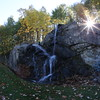 MARY SCHWALM/Staff photo A waterfall at the entrance to Castelton in Windham. 10/12/14