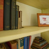 The bookshelf in the dining room displays old books and a photo of livestock on the farm from the 1800's. AMANDA SABGA/ STAFF PHOTO<br /> <br /> The Campbell Farm house in Windham NH on June 26, 2015.