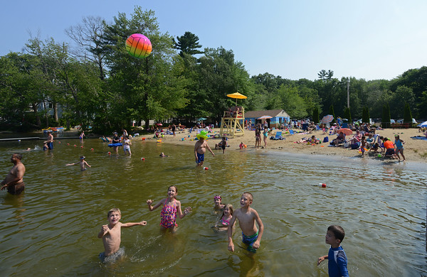RYAN HUTTON/ Staff photo<br /> Children play with a beach ball in Cobbetts Pond at Windham Beach on a hot Sunday in July.